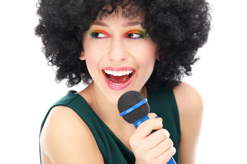 Woman with afro hairstyle holding microphone