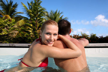Beautiful woman bathing in swimming pool
