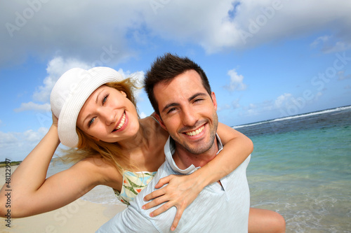Cheerful couple enjoying vacation at the beach