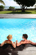 Back view of couple relaxing in swimming pool