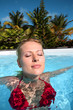 Beautiful woman bathing in swimming pool