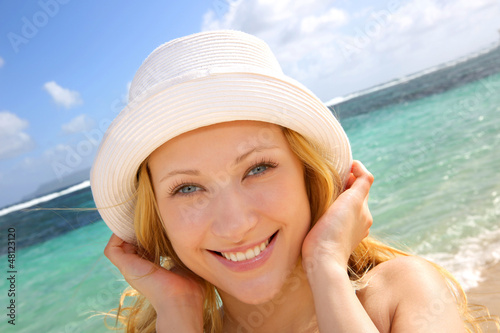 Smiling attractive girl at the beach
