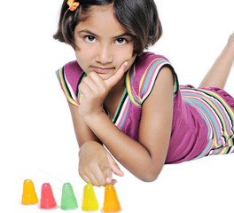 Cute Indian  girl / kid thinking, on isolated white background.