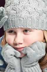 Girl wearing winter hat and gloves