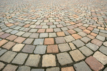 Background in the form of paving bricks (pavers) gray closeup
