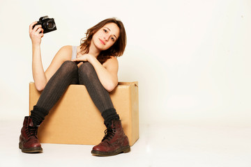 Mädchen in der Box mit Kamera