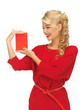 lovely woman in red dress with note card