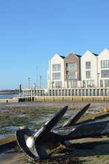 Riverside flats with Anchor in Foreground in portrait format
