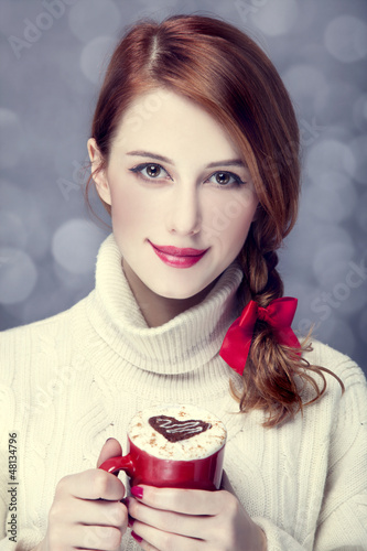 Redhead girl with coffe. St. Valentine Day