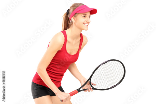 A female tennis player ready to play