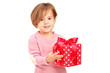 A smiling child holding a gift