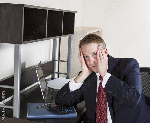 Mature man Stressed at Work