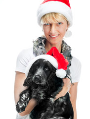woman and dog in santa hats