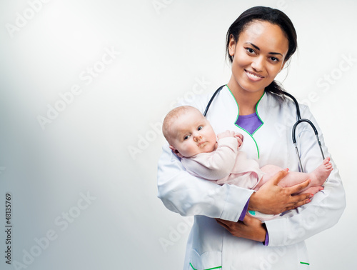 Doctor and baby on a white background