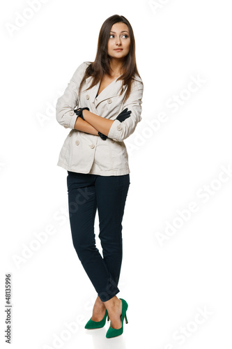 Full length of woman in jacket and gloves standing