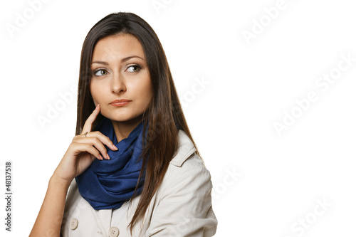 Pensive woman looking to the side at blank copy space