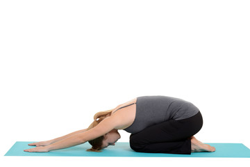 Woman doing yoga on blue map