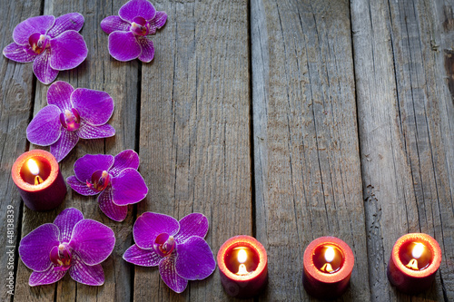 Orchid and candles spa cosmetic abstract vintage background