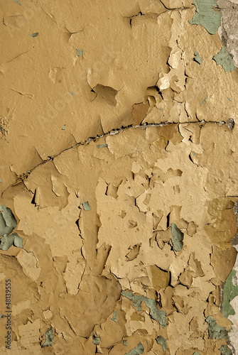 Old crumbling paint layers wall as background