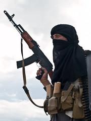 Muslim rebel with AK assault rifle