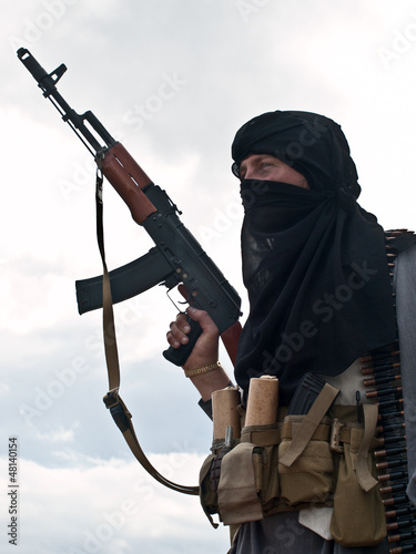 Muslim rebel with AK assault rifle