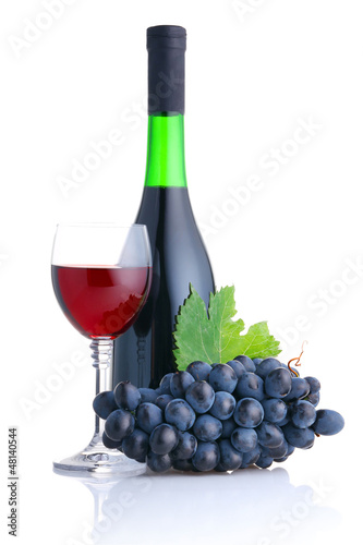 Bottle and glass of red wine with grapes branch isolated