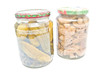 two jars with marinated vegetables on white