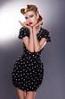 Stylized Retro Woman in Blue Polka Dot Dress - Vintage Style
