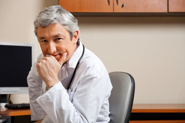 Male Doctor With Hand On Chin