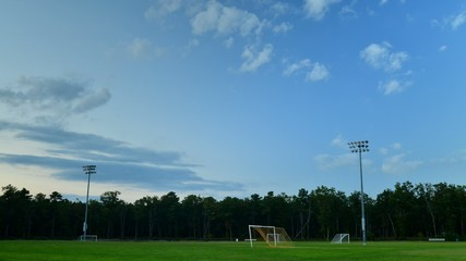 Time Lapse of Soccer Field at dusk with rolling clouds