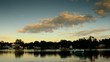 Timelapse of Evening Sky, lake, homes along river bank