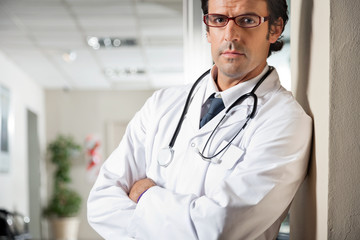 Doctor Standing With Hands Folded
