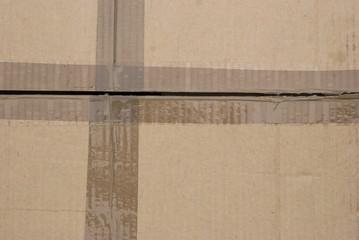 carton stuck with tape