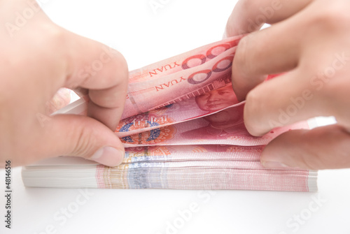 man counting RMB