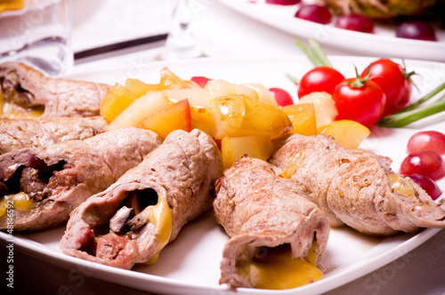 Tasty meat loafs and piece of meat with vegetables