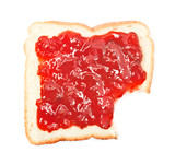 bite out of a slice of bread with strawberry jam