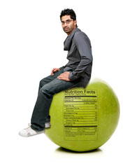 Man Sitting on Red Delicious Apple with Nutrition Label