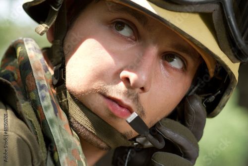 Soldier in helmet talking on a headset