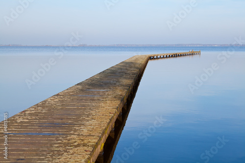 long wooden pier on big lake
