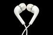 Heart shape white In-earphones isolated on black. - 48151312