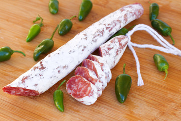 Spanish fuet sausages with green peppers