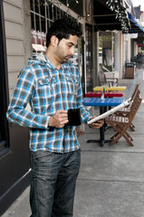 Man Drinking Coffee with Newspaper