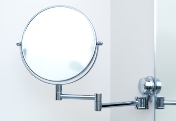 Round wall mirror for the bath. Close-up photo