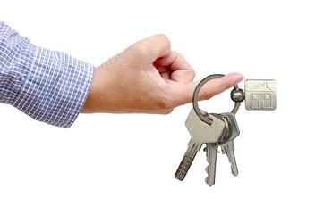 Mano con las llaves de casa nueva.