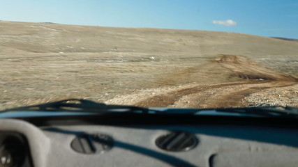 Off Road Driving Through Mountain Plateau