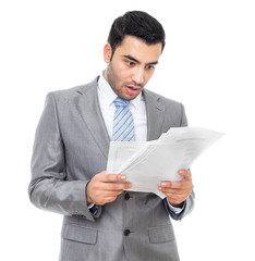 Surprised or shocked businessman holding some documents