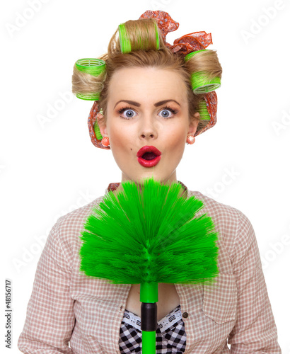 Funny surprised housewife / girl with broom, isolated