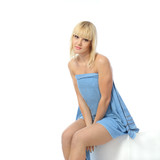 Wet blonde girl wiped blue towel