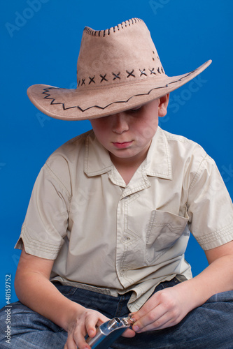 portrait of a boy in a cowboy hat