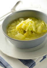 Savoy cabbage soup with potatoes and leek